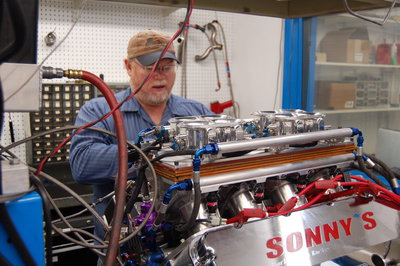 Tom working with an engine on the Dyno. With 2 dynos running, Sonny's has thousands of hours of R&D in engine combinations. Sonny's is leading the way on the popular Electronic Fuel Injection combination, as shown in this picture.
