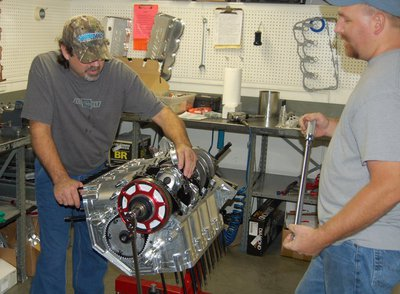Rusty and Chuck assembling an engine, checking rod bolt stretch