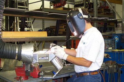 Randy fabricating one of Sonny's custom sheetmetal intakes. Our welding and fabrication shop is second to none making the very best manifolds in the industry today.