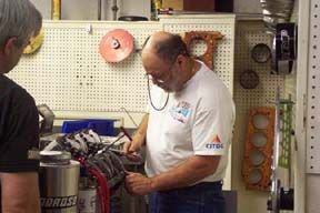 Sonny working on a Hemi Engine.