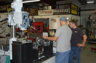 Chuck and Eric balancing crankshaft