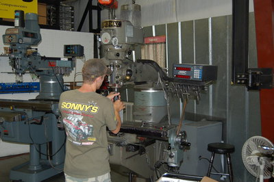 Rick is shown here, setting machine up for gas porting pistons